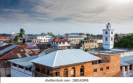 rooftop view over the african city of stonetown zanzibar showing the weathered zinc roofing and city skyline