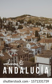 A rooftop view over Granada town, Spain with text written in English 'Welcome to Andalucia'