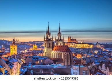 Rooftop view over historical center of Prague, Czech republic, EU. Tyn Church and Prague Castle in beautiful sunset light.