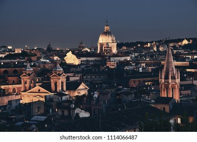 Rooftop view of Rome historical architecture and city skyline at night. Italy.