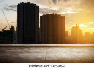 Rooftop view with skyscrapers building and modern city at sunset