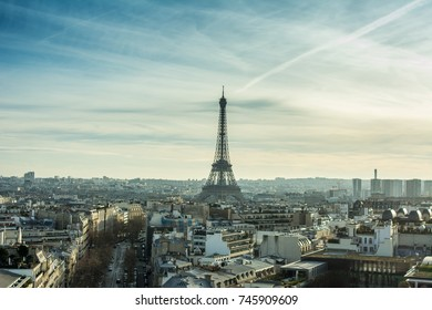Rooftop view with street and Eiffel tower in Paris cities with skyline. The population of Paris is the capital and most-populous city and Attractions of France. Travel through Europe.