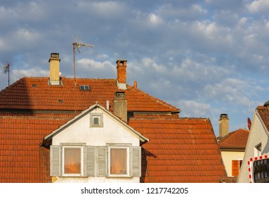 rooftops with antenna of old buildings at sunny afternoon in south germany