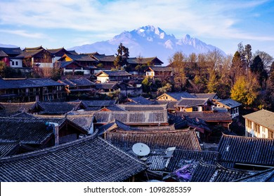 Rooftops in Lijiang old town and jade dragon snow mountains in the background, beautiful view from Lijiang
