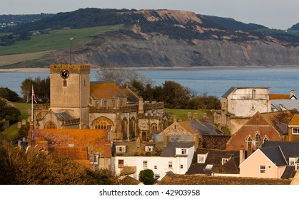 Rooftops of Lyme Regis with the jurassic coastline in the background