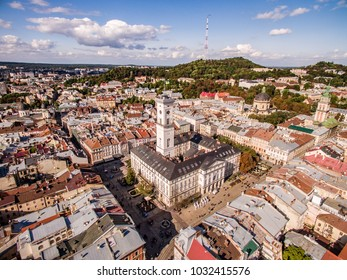 Rooftops of the old town in Lviv in Ukraine during the day. The magical atmosphere of the European city. Landmark, the city hall and the main square. Drone photo.