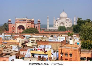 Rooftops of Taj Ganj neighborhood and Taj Mahal in Agra, India. Taj Mahal was build in 1632 by Emperor Shah Jahan as a memorial for his second wife Mumtaz Mahal.