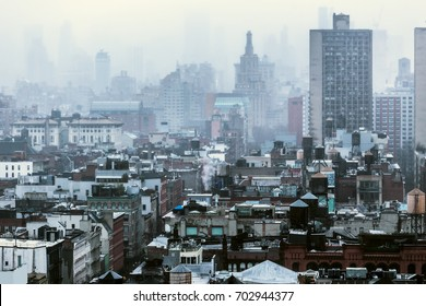 Rooftops of the Tribeca area in Manhattan, New York City during a gloomy, foggy and overcast winter day.