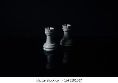 Rook in chess. White rooks on chess pieces are isolated in black