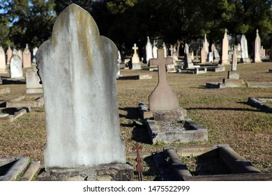 Rookwood, NSW Australia - August 11, 2019 - old gravestones at Sydney's oldest and largest working cemetery - a close-up of two blank headstones with others in the background