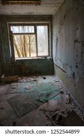 Room in abandoned hospital No. 126, dead ghost town of Pripyat in Chernobyl NPP alienation zone, Ukraine
