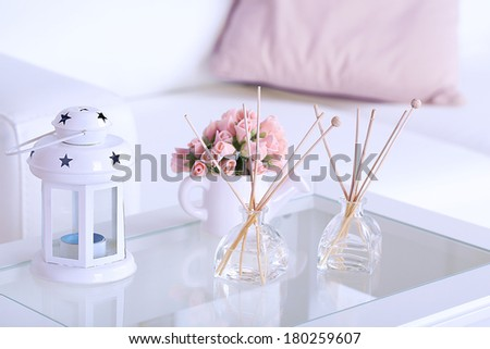 Room air refreshers and decorations on table, close-up, on home interior background