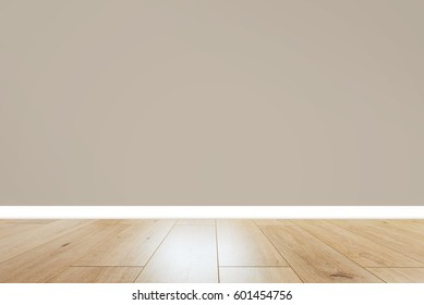 room with beige wall and wooden floor