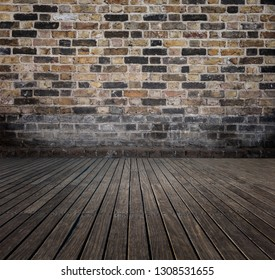 room with bricks wall and wooden floor