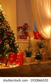 Room with Christmas decorations in evening. Festive interior design