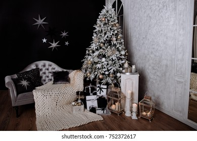 The room decorated by Christmas. A big fir-tree with Christmas jewelry and gifts