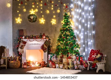 Room decorated for the celebration of the new year. Beautiful Christmas location with a Christmas tree, a fireplace and a lot of gifts
