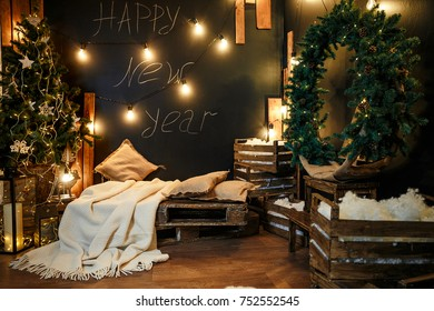 Room decorated with Christmas tree, fairy lights and wreath.