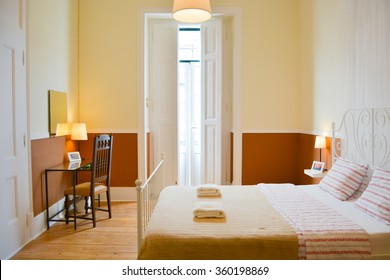 Room with double bed in a hostel in Lisbon