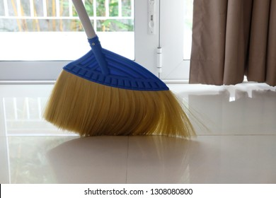 Room floor cleaning use broom in modern house