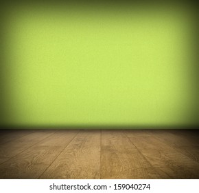 Room with green concrete pattern wall and wooden floor background