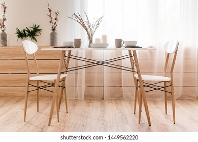 The room has a dining table on which the serving of breakfast