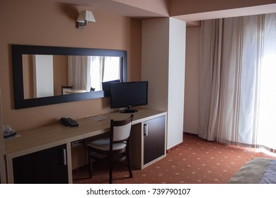 room in the hotel with black telephone and TV and wardrobe desk