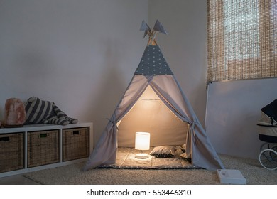 room in the house with the tepee