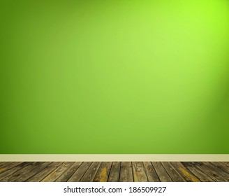 room interior with green wall and wooden floor