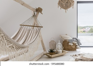 Room interior with hammock and stylish decorations