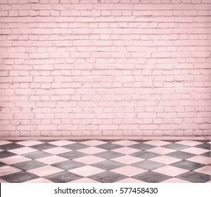 Room interior with pink brick wall and tiled floor