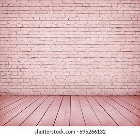 Room interior with pink brick wall and wooden floor