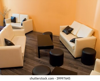 Room interior with sofas, table and stools
