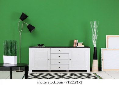Room interior with TV stand on color wall background