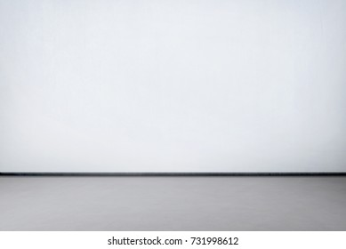 Room interior with white wall and concrete gray floor for backdrop
