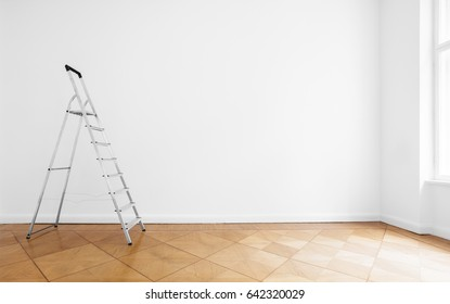 room with ladder and white wall background, renovated