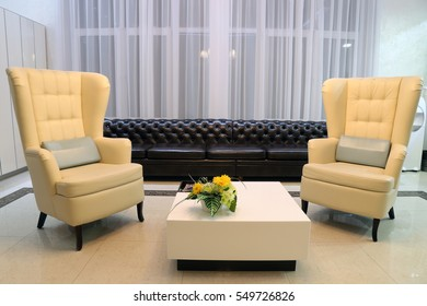room with leather sofa and armchairs