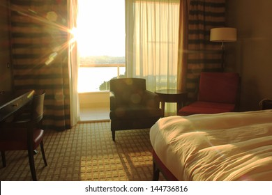 Room in luxury hotel illuminated by sunlight