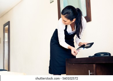 Room Maid Looking Through Hotel Guest's Wallet