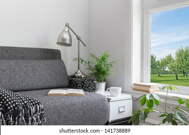 Room with modern decor and beautiful view over green garden.