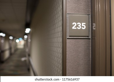 Room number sign on the wall