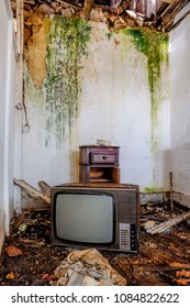 room in an old abandoned house with some objects