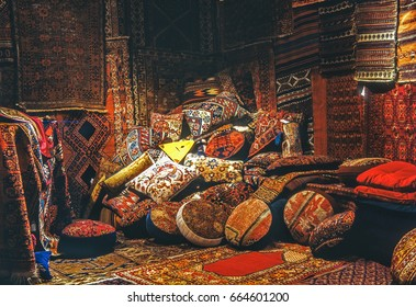 Room with oriental rugs and pillows covered with rugs