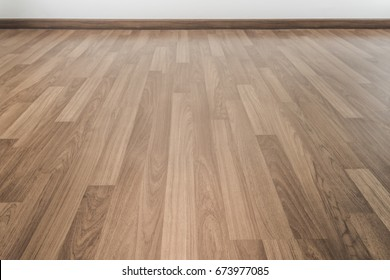 A room with pale wood parquet floor.