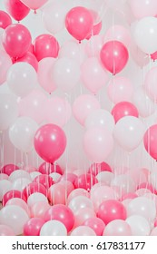 The room with pink balloons