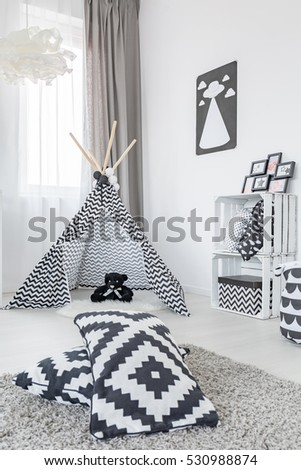 Room with play tent, carpet, pattern pillows and crate storage