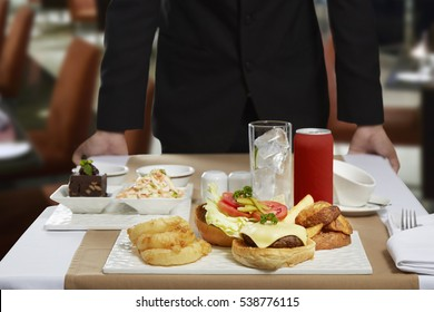 """Room service or """"in-room dining"""" is a hotel service enabling guests to choose menu items for delivery to their hotel room for consumption there, served by staff."""