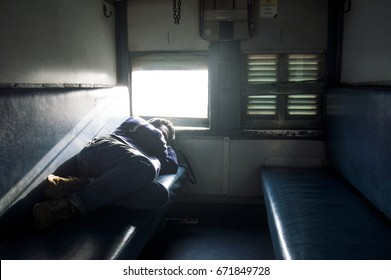 the room of the sleeper class in indian train with passenger sleeping