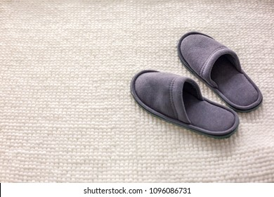 room Slippers are on a soft rug, the concept of comfort and convenience