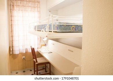 Room with an upper bed and a studio